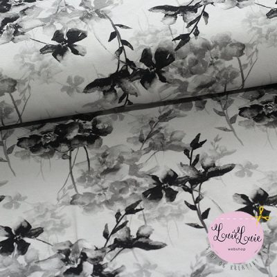 Bomuldsjersey med sorte blomster på hvid bund
