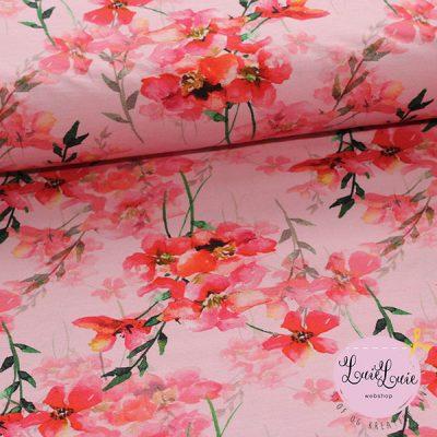 Bomuldsjersey med rosa blomster på rosa bund