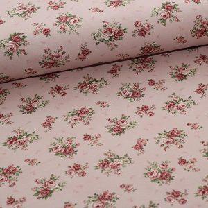 Bomuldsjersey med roser på rosa bund