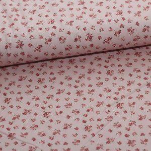 Bomuldsjersey med små roser på rosa bund